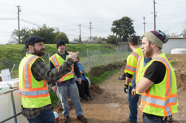OWP's Brian Currier instructs student interns on proper stormwater sampling techniques